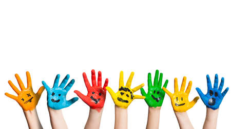 painted hands of children with smileys