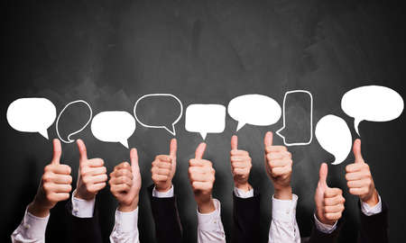 alright: many thumbs up with speech bubbles  Stock Photo