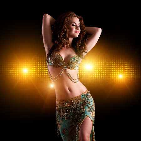 attractive brunette bellydancer on stage  photo