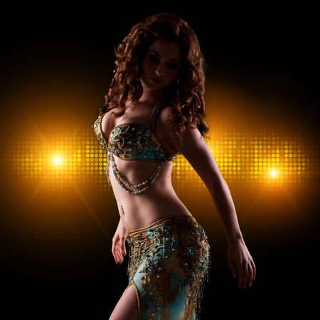attractive brunette bellydancer on stage