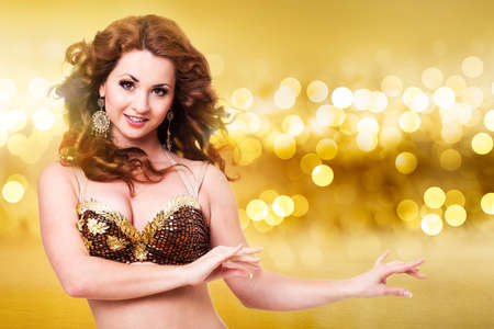 attractive oriental dancer in front of many twinkling lights