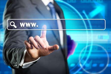 business man entering a web address  photo