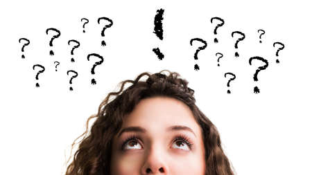 confused woman: young woman having an idea besides many questions  Stock Photo