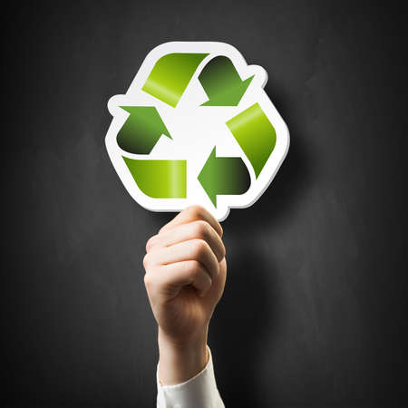 human energy: hand holding a recycling symbol  Stock Photo
