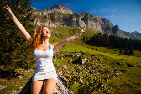 happy young woman in alpine landscape