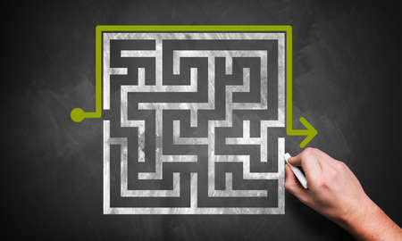 man drawing a maze with a workaround photo