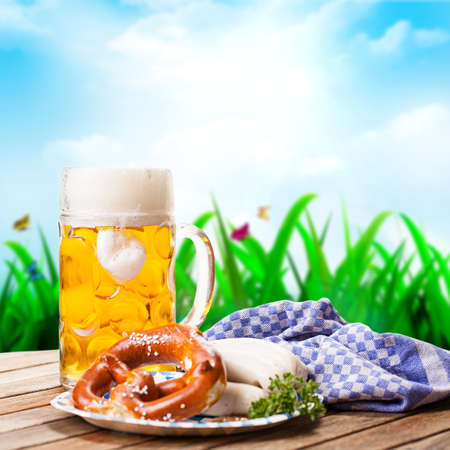 beer with pretzel and sausages photo