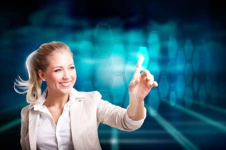 businesswoman pressing a virtual button  photo