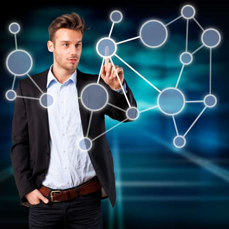 node: young man touching a node in a network  Stock Photo