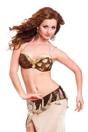bellydance: attractive dancing bellydancer on isolated background