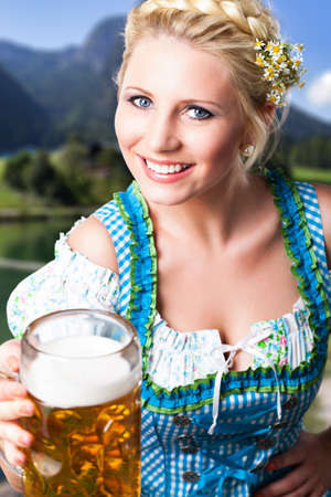 wiesn: attractive young girl in a dirndl with a beer