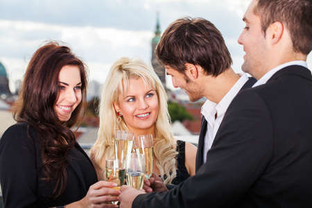 looking after: group of friends clinking glasses