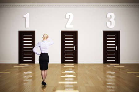 difficult decision: businesswoman with difficult decision between 3 options Stock Photo