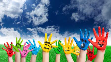 many children hands with smileys 版權商用圖片