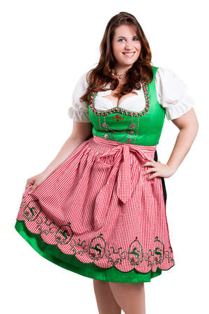 young woman in a traditional dirndl smiling into the camera  photo