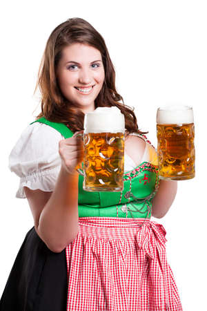 young woman in a dirndl with two beer  photo