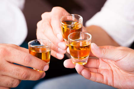 three people with rum shots  photo