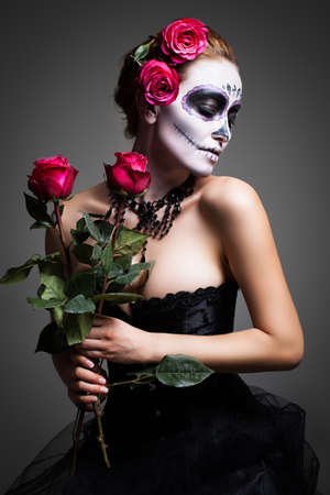 mexican girl: attractive woman with sugar skull make up