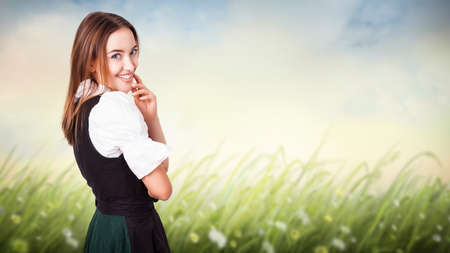 attractive woman in a traditional dirndl  photo