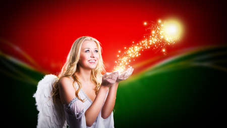 attractive blonde angel with christmas magic photo
