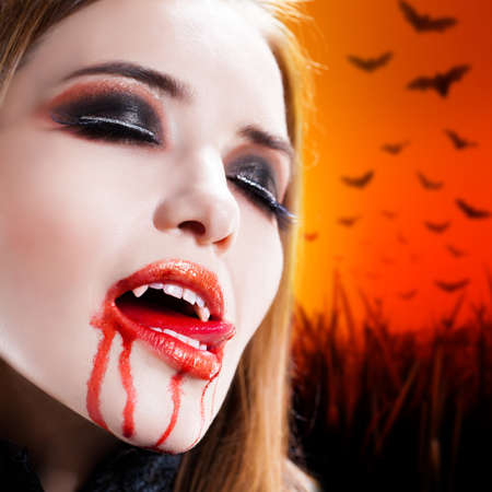 vampire teeth: attractive vampire with bloody mouth