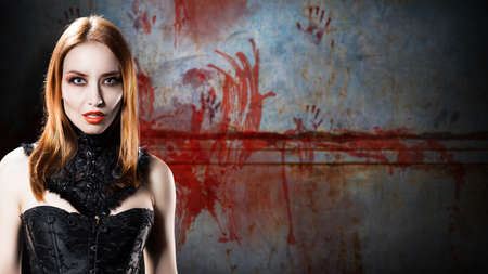 lascivious: female vampire in front of a bloody wall