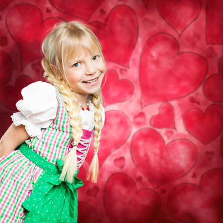 dirndl: happy young girl in a dirndl