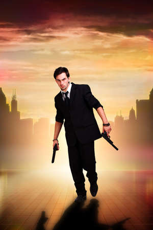 man with guns in front of a cityscape