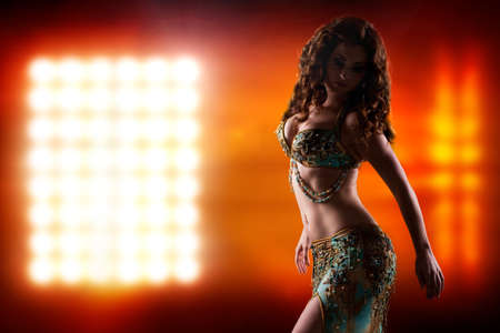belly dance: attractive brunette bellydancer on stage