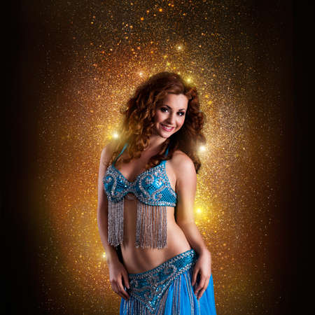 bellydance: attractive oriental dancer in front of many twinkling lights
