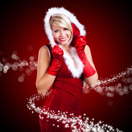attractive miss santa with twinkling stars photo