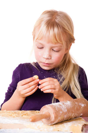 nibbling: cute little girl nibbling on christmas pastry Stock Photo