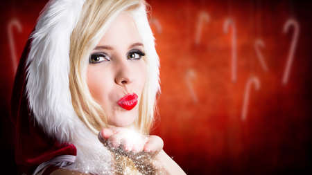 attractive miss santa with kiss gesture photo