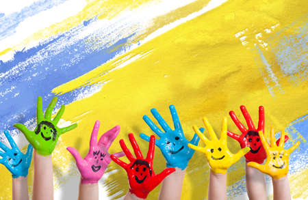many colorful hands with smileys 版權商用圖片
