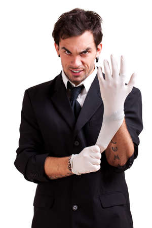 latex glove: man in a suit puts medical gloves on