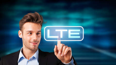 lte: business man pressing on LTE button Stock Photo