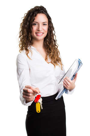 young businesswoman with keys and files 版權商用圖片