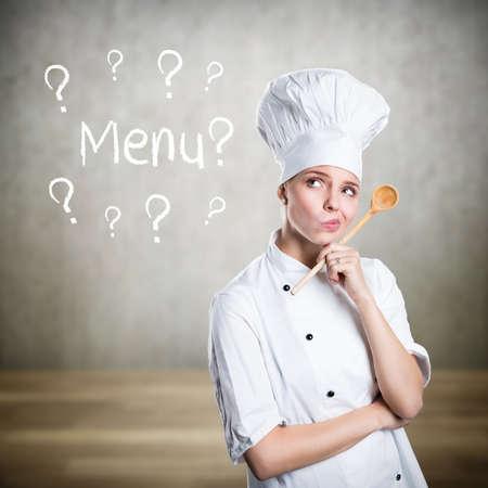 jonge kok denken over een menu Stockfoto