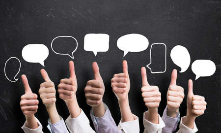 many thumbs up with speech bubbles Stock Photo