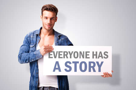 founders: man holding a sign Stating \\ \Everyone Has a Story \\\ Stock Photo