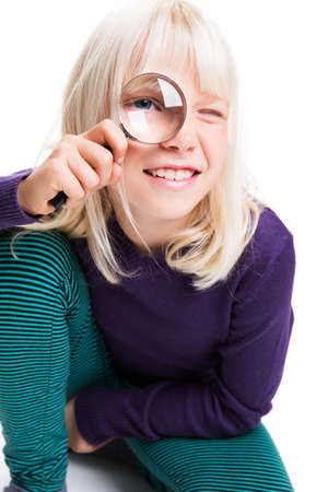 lupe: young girl with magnifying glass Stock Photo