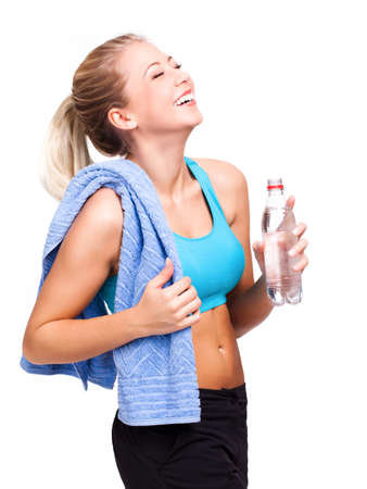 attractive woman after workout with a bottle of water photo