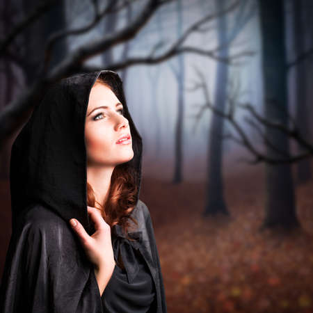 young witch in a forest