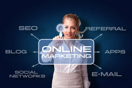 successful campaign: young woman starts online marketing campaign Stock Photo
