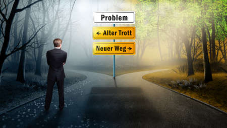businessman has to decide between the two options old way and new way (in German) photo