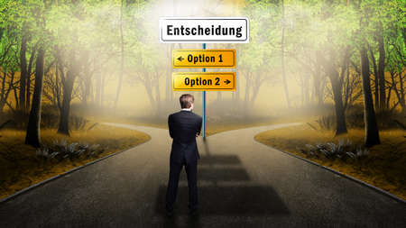 new direction: man has to decide to go to option 1 or option 2, with the heading \\\decision\\\ in German Stock Photo