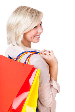 bargain hunting: young woman with many shopping bags