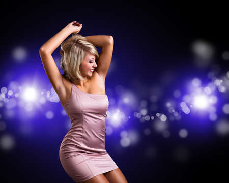 sexy girl dance: attractive young girl in front of a club background Stock Photo