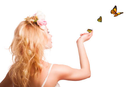 butterfly hand: attractive blonde woman with butterflies
