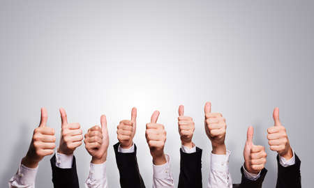 collectives: many thumbs up Stock Photo